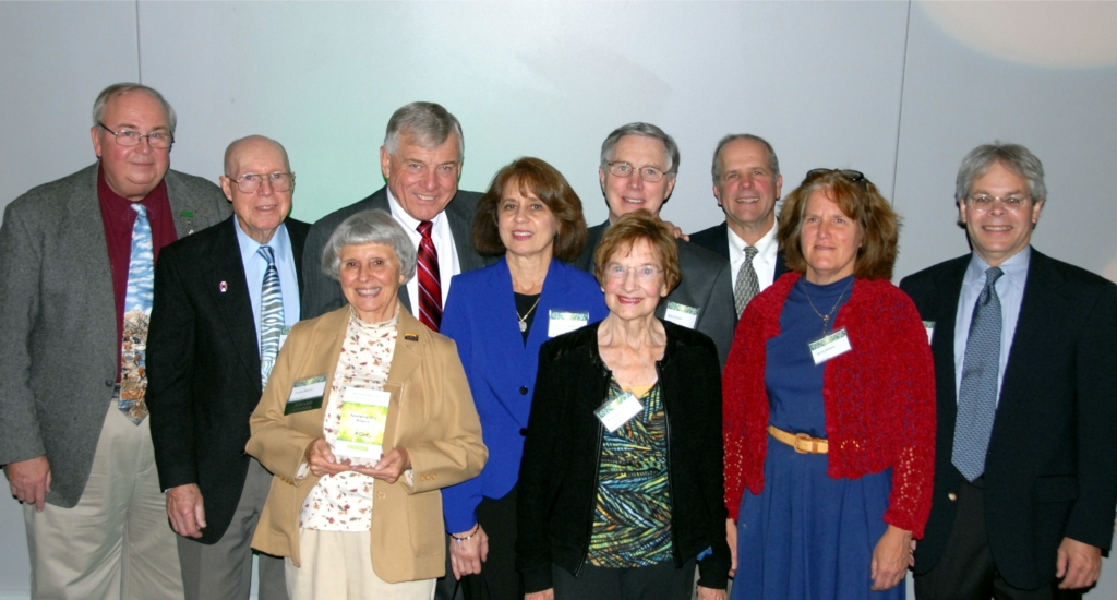 Accepting the award for AOA are Steve Goodwin (Land Protection Specialist), Clyde Gosnell (Treasurer and Co-founder), Omie Warner (Vice President and Co-founder), Guy Denny (Ohio Natural Areas and Preserves Association), Sandy Chiaramonte, Russ Scholl (Board Member), Rosemary Joyce (Co-founder), Al Altfater (President), Betty Altfater, and Steve Fleegal (Executive Director) - Photo by Mark Dilley