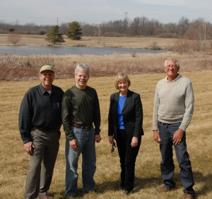 AOA President Al Altfater, Director Steve Fleegal, and Franklin County Commissioner Paula Brooks visit with the bog site with Jack Utzinger