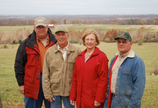 Steve with Barr family working on the conservation of the Snake Den Mounds archaeological site and Mound View farm - shown in the background.  Pictured from left to right:  Steve Goodwin, Dean Barr, Pat Barr and James Barr. Photo by Gail Keck.